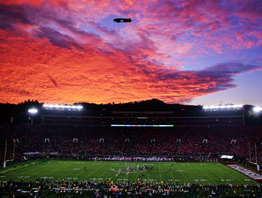 The sunset over the Rose Bowl on New Year's Day, with colors reflected by clouds.