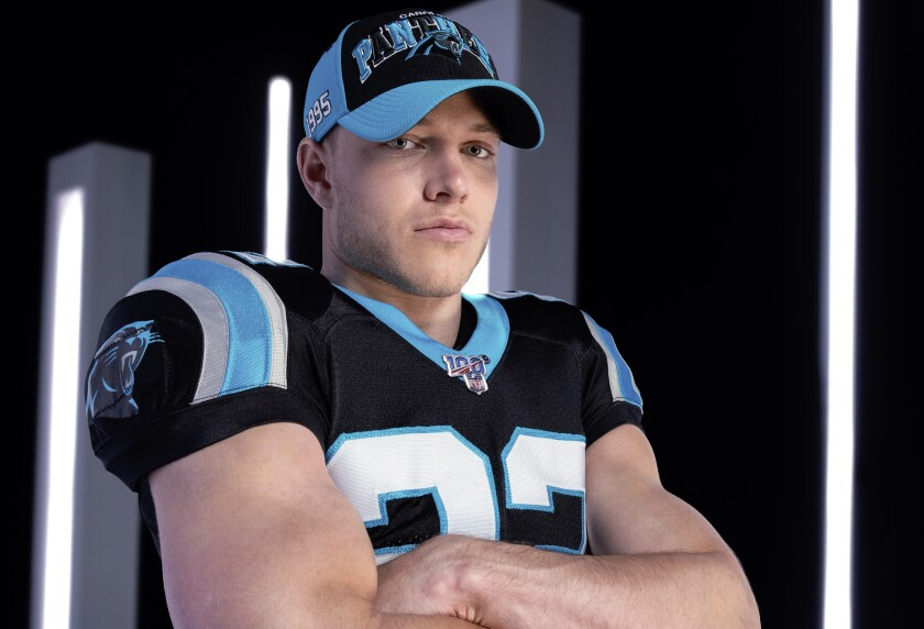 Carolina Panthers running back Christian McCaffrey wears the team's 2019 sideline cap.