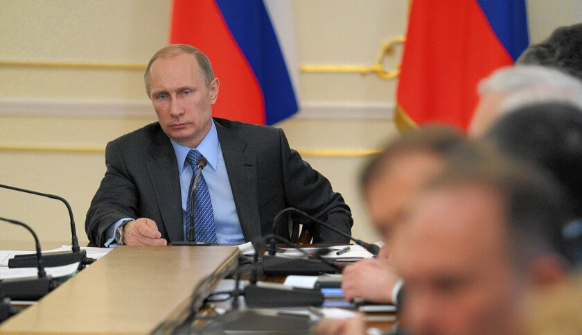 Russian President Vladimir Putin holds a meeting outside Moscow with government officials. A day after Putin signed a treaty to annex Crimea, U.S. officials acknowledged that Ukraine has lost the region.