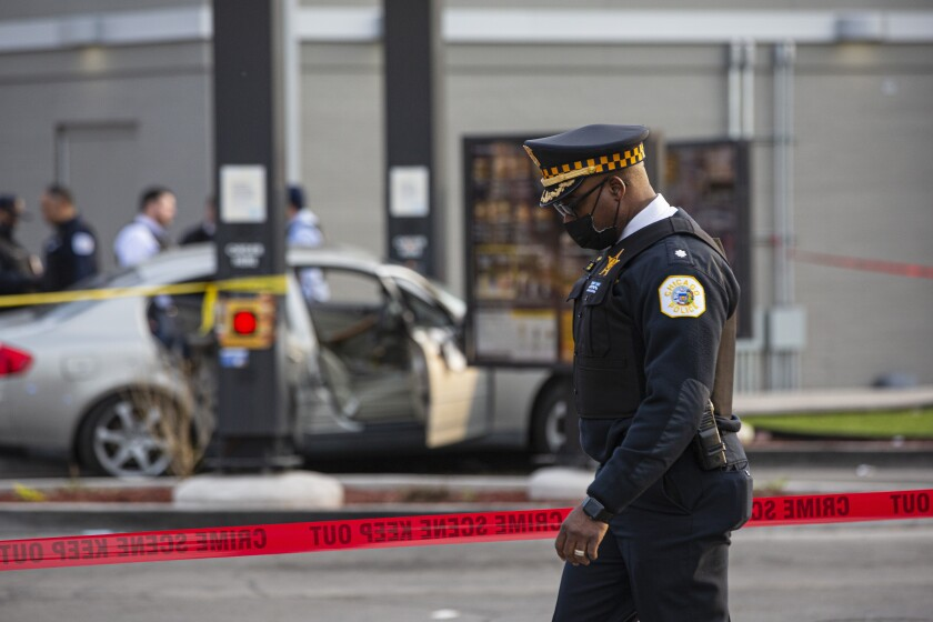 A police commander walks by as police investigate a crime scene where Jontae Adams, 28, and his daughter Jaslyn, 7, where shot, resulting in Jaslyn's death at a McDonald's drive-thru at the corner of W. Roosevelt Road and South Kedzie Avenue, Sunday, April 18, 2021, in Chicago. (Anthony Vazquez/Chicago Sun-Times via AP)