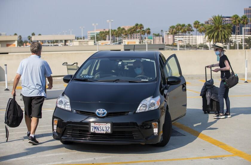 Jeff and Christy Labarthe take an Uber driven by Arad Aryan at John Wayne Airport.