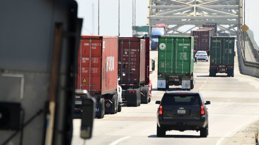 LOS ANGELES, CALIFORNIA JULY 19, 2017-Trucks make there way up the Gerald Desmond Bridge at the Port