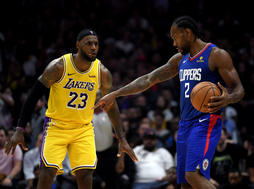 Kawhi Leonard sets up the Clippers offense while guarded by Lakers forward LeBron James during a game earlier this season.