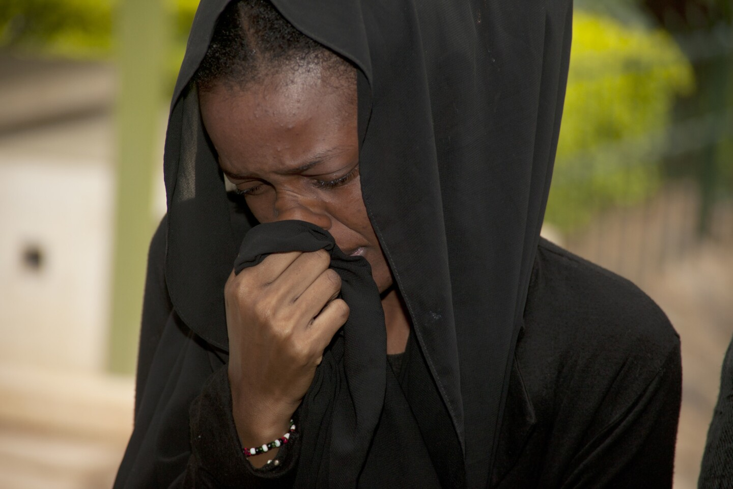 A weeping relative reacts after viewing the body of a family member killed in Thursday's attack on a university, at Chiromo funeral home, Nairobi, Kenya, Saturday, April 4, 2015.