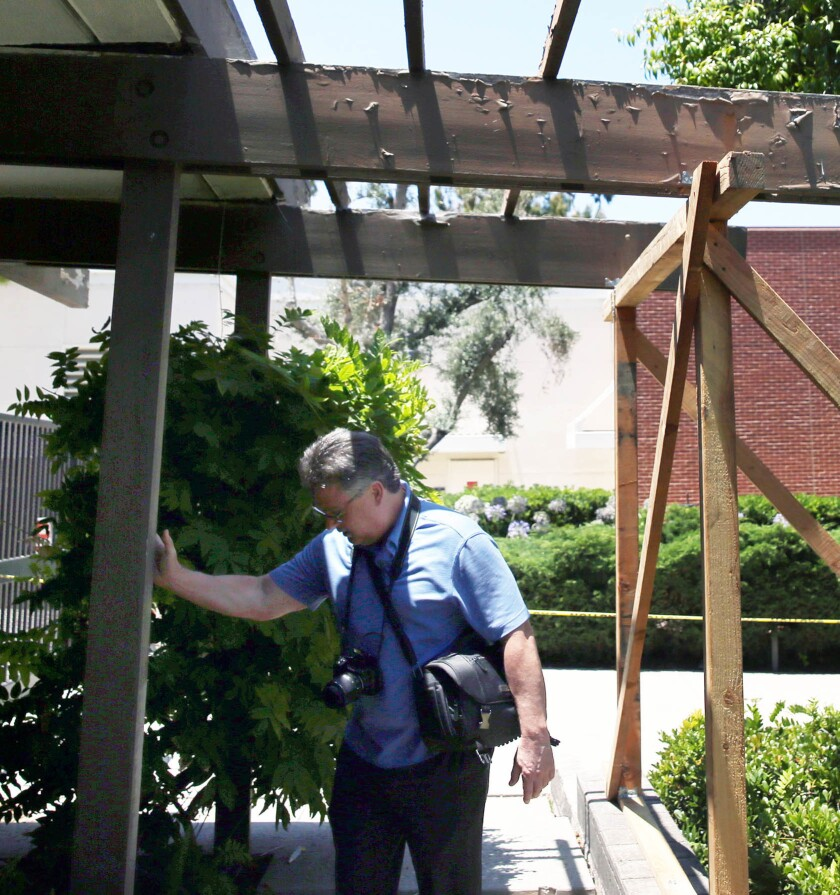 LOS ANGELES, CA-JULY 12, 2019: President at Seneca Structural Engineering, Inc. K. Dirk Bondy checks
