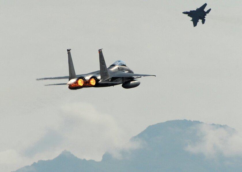 A pair of F-15C Eagles take off from Joint Base Elmendorf-Richardson near Anchorage in 2015,