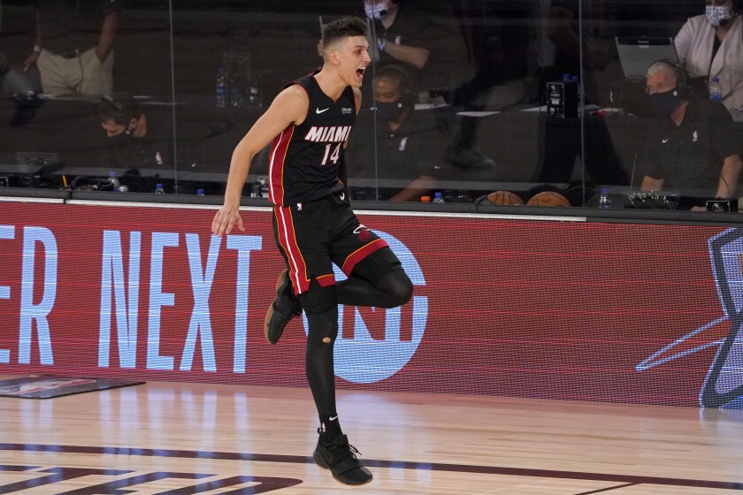 Miami Heat's Tyler Herro (14) celebrates late in the second half of an NBA basketball conference semifinal playoff game against the Milwaukee Bucks on Monday, Aug. 31, 2020, in Lake Buena Vista, Fla. (AP Photo/Mark J. Terrill)