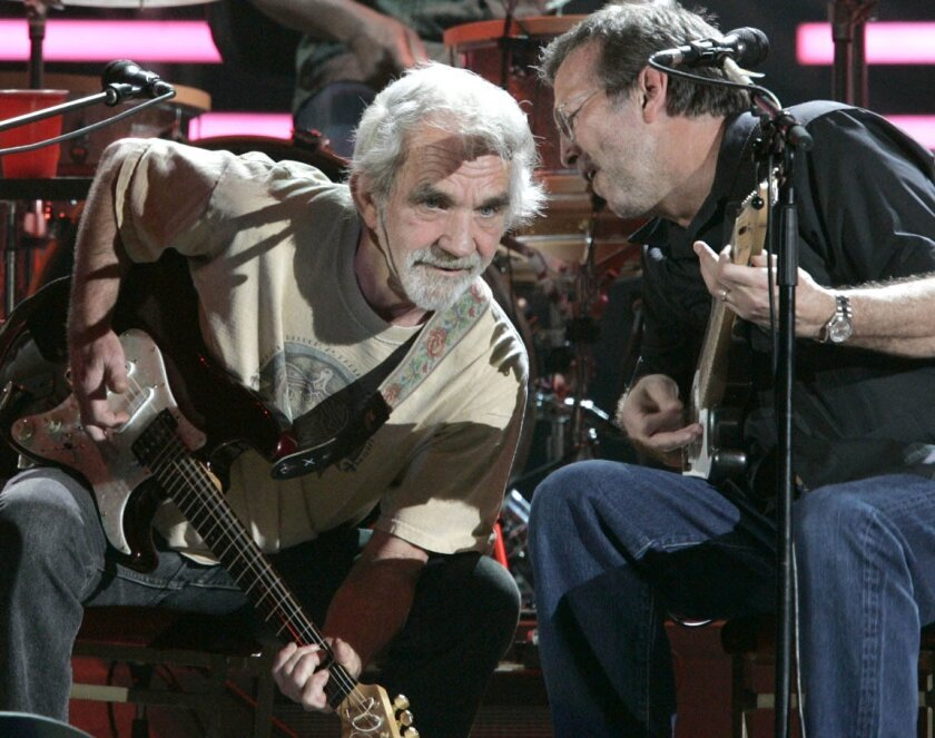 San Diego, CA _ Spotlight-shunning singer-songwriter J.J. Cale (left) shared the stage with legendary guitarist Eric Clapton, a longtime fan, at the San Diego Sports Arena on March 15, 2007.  Cale, a longtime Valley Center resident, died July 26, 2013, in a La Jolla hospital following a heart attac