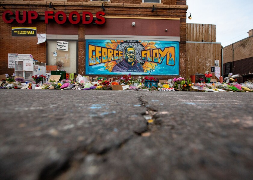The mural and makeshift memorial outside Cup Foods, where George Floyd was murdered.