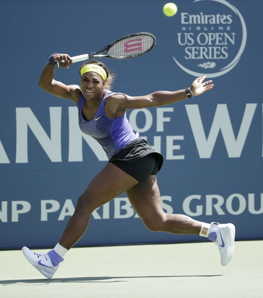 Serena Williams returns to Angelique Kerber, of Germany, during the championship match of the Bank of the West Classic tennis tournament on Sunday, Aug. 3, 2014, in Stanford , Calif. (AP Photo/Marcio Jose Sanchez)
