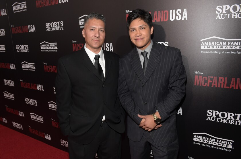 "Jose Cardenas, left, and actor Johnny Ortiz attend the premiere of Disney's ""McFarland, USA"" at the El Capitan Theatre on Feb. 9, 2015, in Hollywood, California."