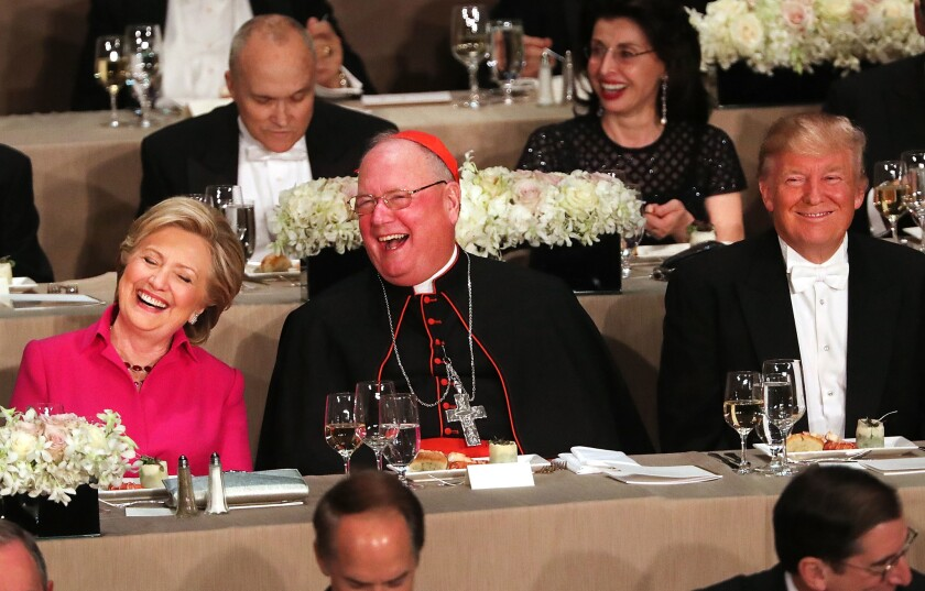 Hillary Clinton and Donald Trump had only Cardinal Timothy Dolan separating them at the annual Alfred E. Smith Memorial Foundation Dinner in New York.