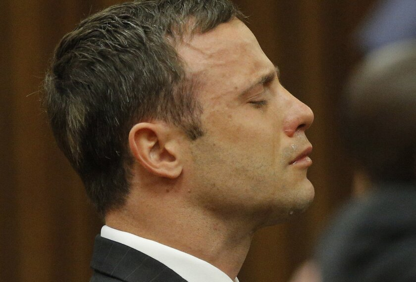 Oscar Pistorius reacts as the judge delivers the verdict during his murder trial in Pretoria, South Africa, on Sept. 11, 2014.