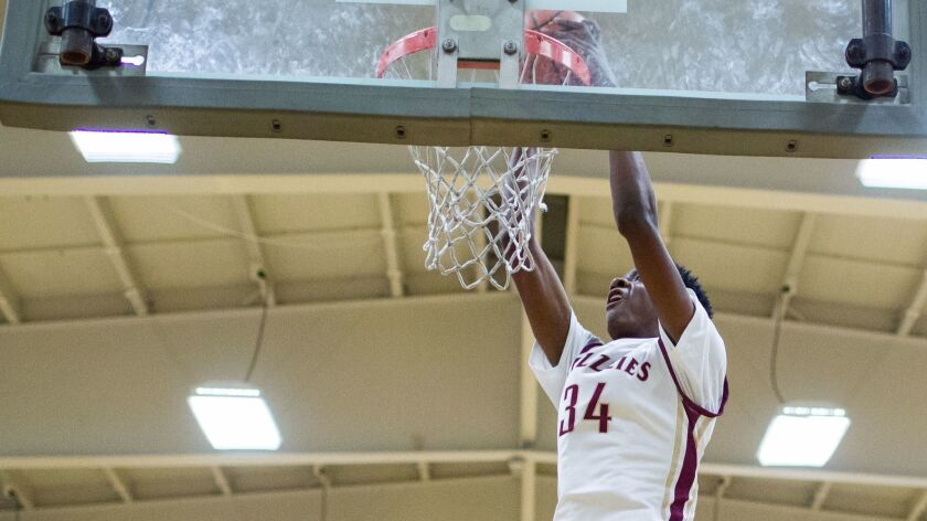 Mission Hills' Warren Washington dunks against La Salle.