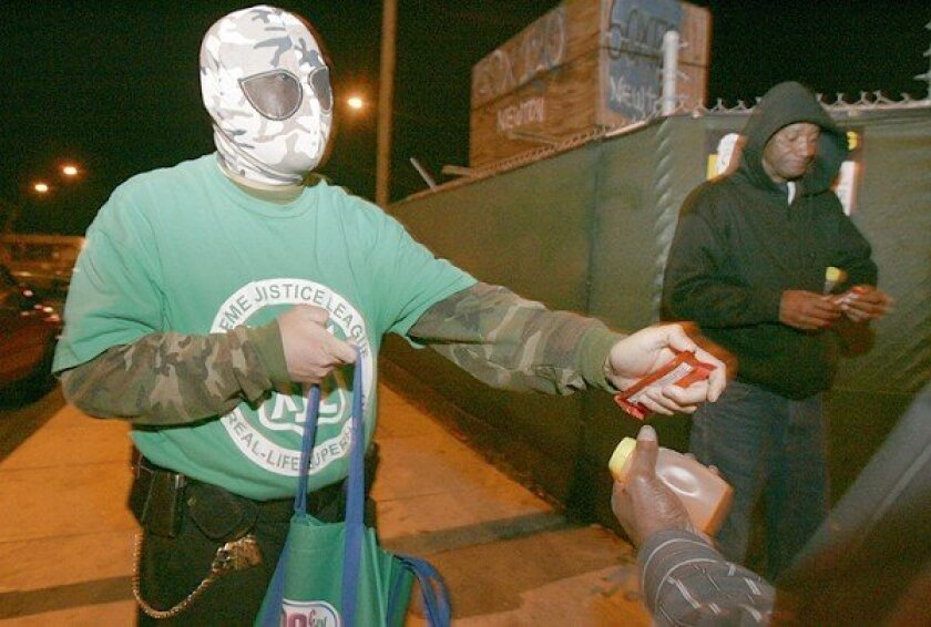 Mr. Xtreme, a self-proclaimed superhero, patrolled the streets of East Village, handing out food and juice.
