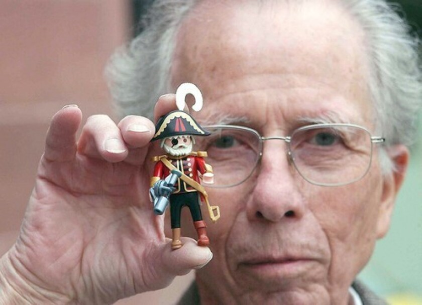 """Hans Beck designed the Playmobil figurines partly as a response to the 1970s oil crisis, which made larger plastic toys more expensive. Beck said he strove for """"no horror, no superficial violence, no short-lived trends"""" in his designs."""