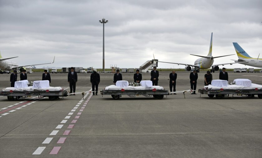 Bodies of terror victims returned to Japan