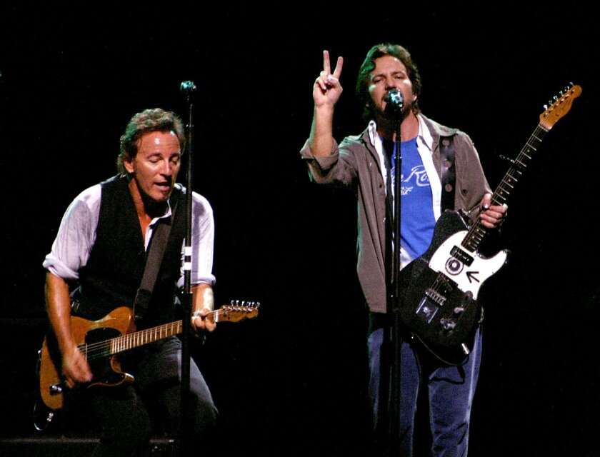 EAST RUTHERFORD, NJ - OCTOBER 13:  Eddie Vedder of Pearl Jam (R) joins Bruce Springsteen and the E Street Band during the Vote For Change concert at the Continental Airlines Arena October 13, 2004 in East Rutherford, New Jersey. (Photo by Paul Hawthorne/Getty Images)