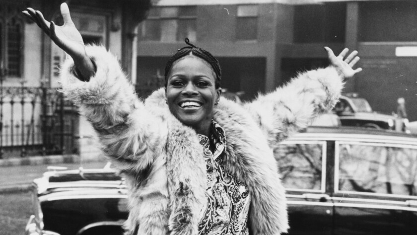 A young Cicely Tyson smiles in a fur coat