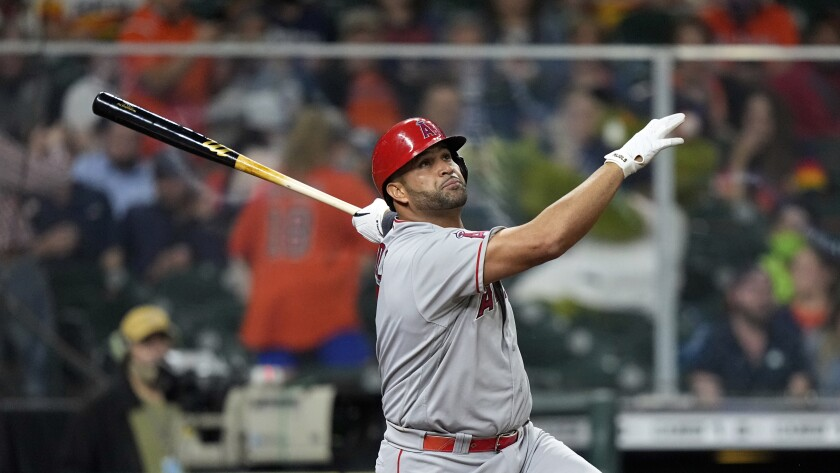 The Angels' Albert Pujols watches his home run sail against the Houston Astros in April.