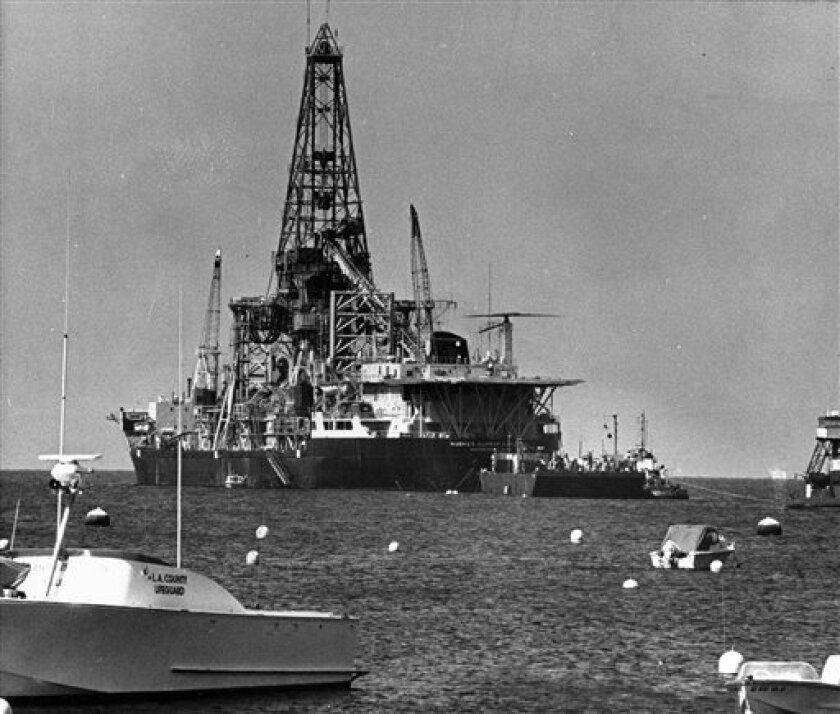 FILE - In this May 8, 1975, file photo boaters watch the arrival of the Hughes Glomar Explorer off Catalina Island, Calif.  In August 1974 the ship fished a sunken Soviet nuclear-armed submarine out of the Pacific Ocean depths, took what it could of the wreck, and made off to Hawaii with its purloi