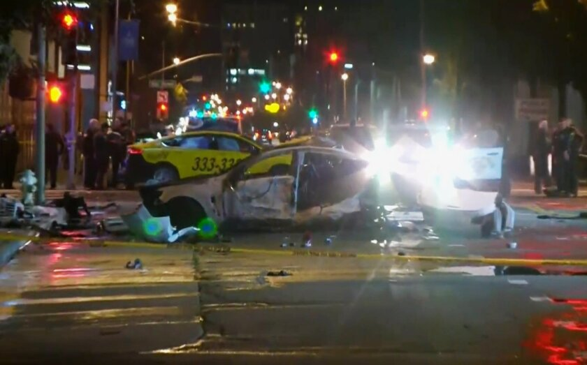 This Feb. 6, 2016 image provided by KPIX CBS 5 shows police and fire officials responding after a car crash that killed a few people on a San Francisco street. California Highway Patrol spokesman Officer Vu Williams said the brief chase Saturday night began after an officer tried to pull over the d