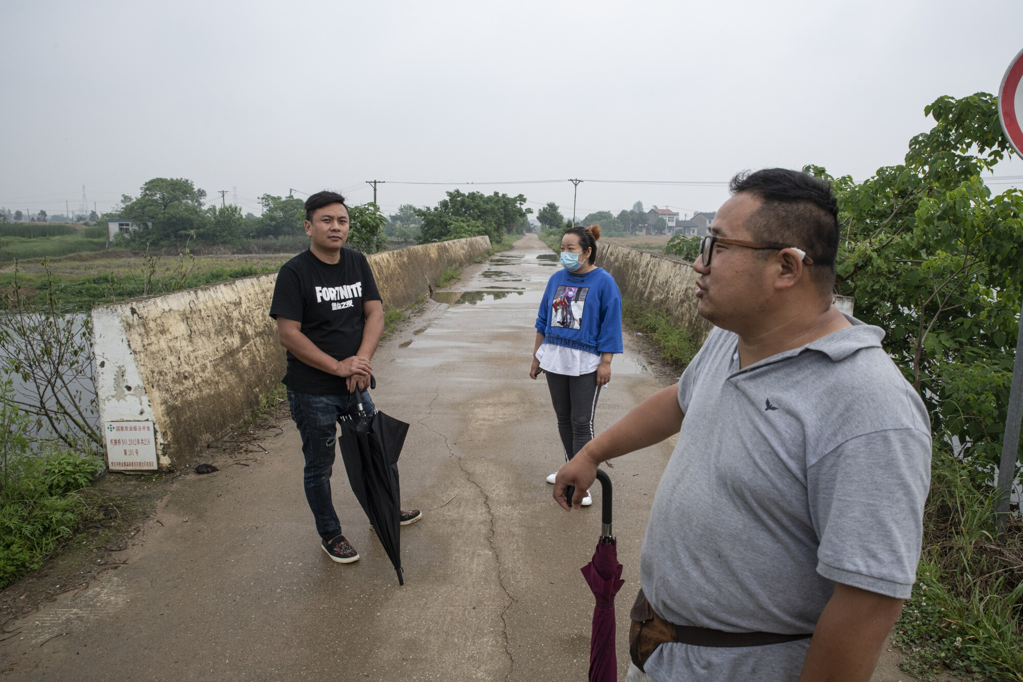Chen Wenxi, left, and Pan Bangfeng, right, best friends and migrant workers, in their home village.