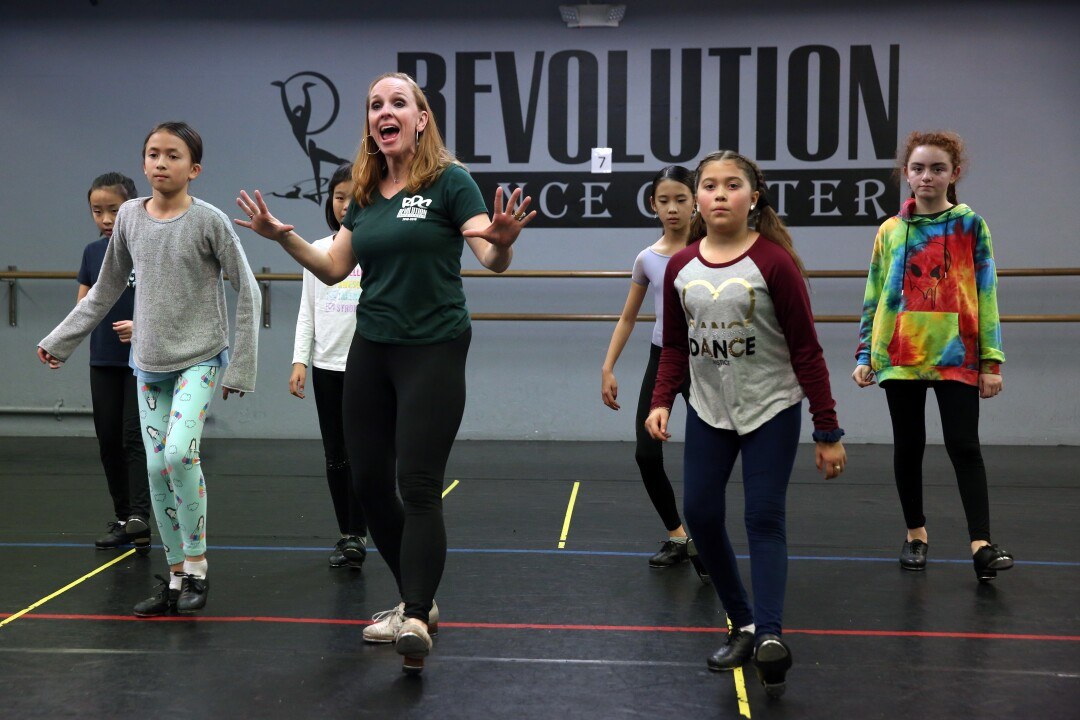 Julie Kay Stallcup leading a group of kids in a tap dance lesson.