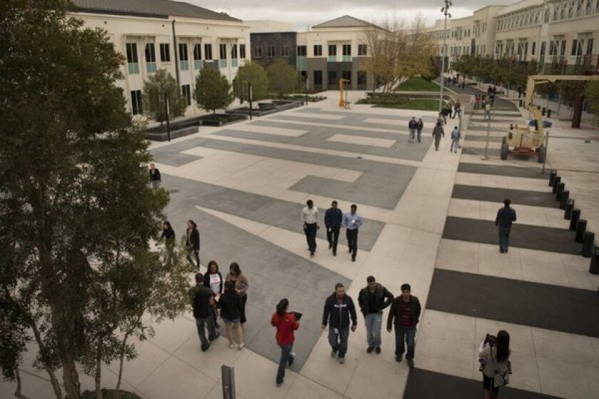 Twenty-four hours after Facebook opened its polls, more than 100,000 users have cast their votes 10 to 1 against Facebook's proposed changes to its privacy and data-sharing policies. Above, Facebook employees walk the grounds of Facebook's Menlo Park, Calif., headquarters.
