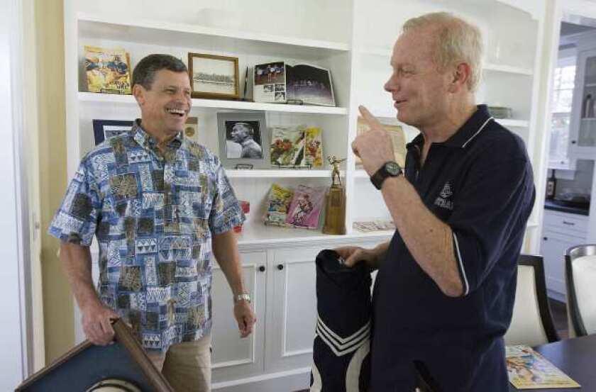 Newport Harbor High alumni Tony Horvath, left, and Randy Hamilton are producing a documentary about the 1970 Sailors' football team.