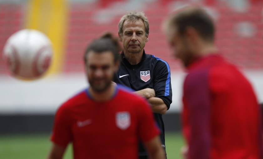 United States Coach Juergen Klinsmann watches as players practice.