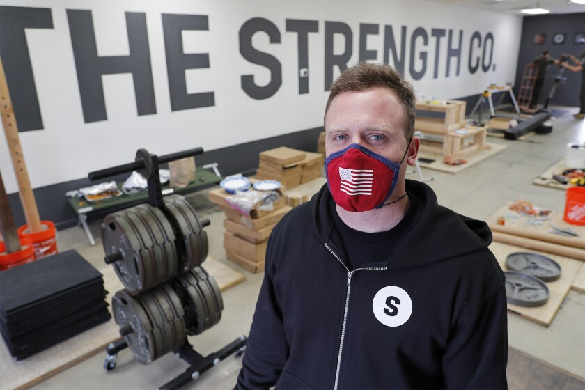 Grant Broggi, the Strength Co. owner, closed his strength training gym and began manufacturing his own wooden and steel squat racks to sell to people so they could work out at home.