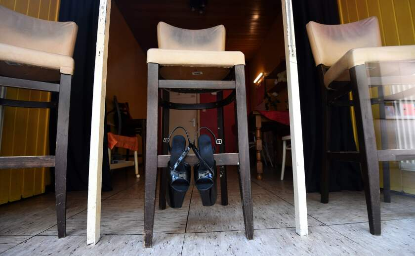 Shoes hang on a bar stool in a closed brothel in Dortmund, Germany, where many activities came to a halt due to the coronavirus.