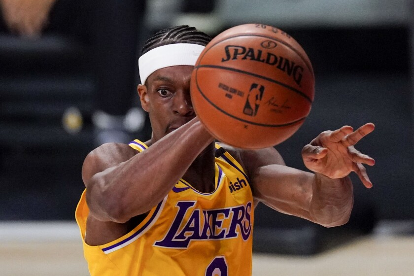 Los Angeles Lakers guard Rajon Rondo passes against the Miami Heat during the first half in Game 4 of basketball's NBA Finals Tuesday, Oct. 6, 2020, in Lake Buena Vista, Fla. (AP Photo/Mark J. Terrill)