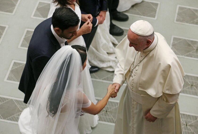 Pope Francis greets newlywed couples during the weekly general audience in the Vatican, Vatican City, on Wednesday.