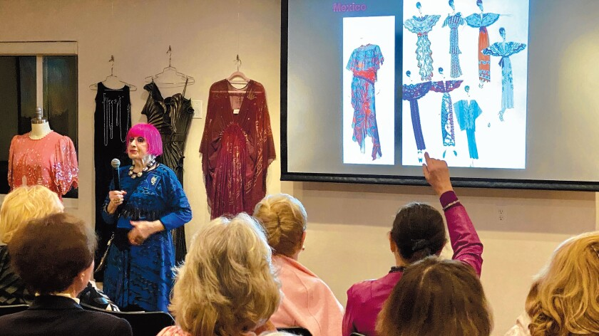 Fashion designer Zandra Rhodes takes questions and explains her hand-printed fabric process using sample gowns from many of her collections at La Jolla Community Center's Distinguished Speaker Series on March 3, 2020.