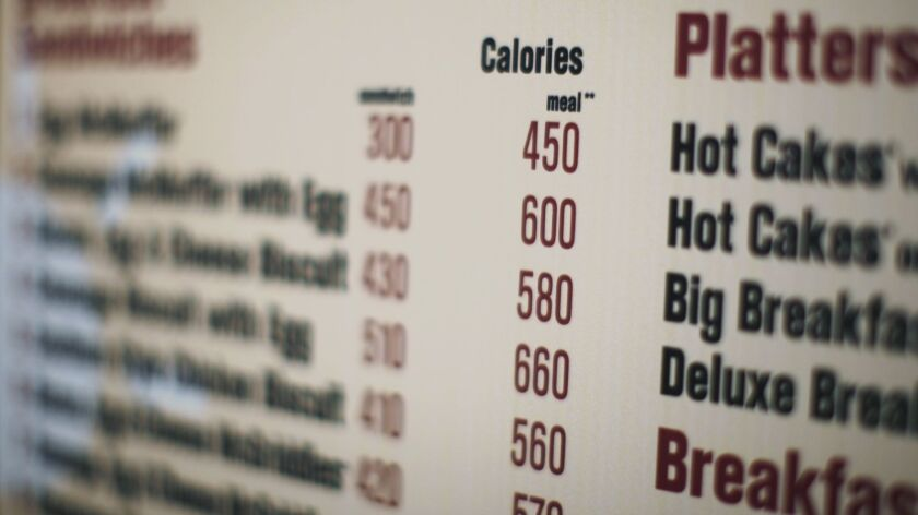 FILE - In this July 18, 2008 file photo, calories of each food item appear on a McDonalds drive-thru
