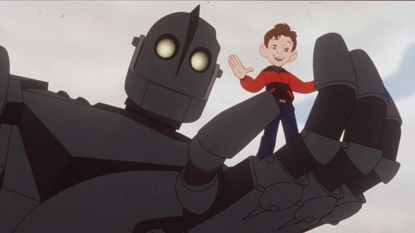 """The Iron Giant and Hogarth (voiced by Eli Marienthal) in the 1999 animated feature """"The Iron Giant."""""""