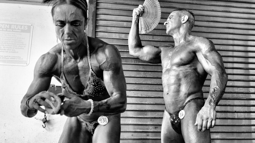 Body Bender: A middle-aged bodybuilder couple from Spain makes final preparations to go on stage, wh