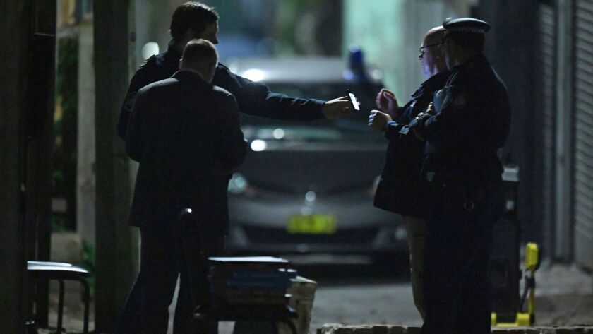 Australian police work in Sydney's Surry Hills suburb on July 29, 2017. Law enforcement officials raided properties in several Sydney suburbs and arrested four people on suspicion of plotting a terrorist attack.