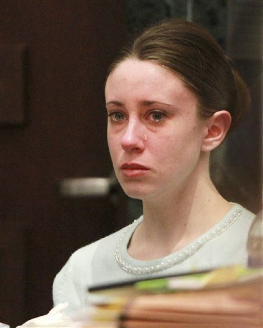 A tear rolls down the cheek of Casey Anthony during a recess after her mother Cindy Anthony testified during her murder trial at the Orange County Courthouse, in Orlando, Fla., Saturday, May 28, 2011. Casey Anthony is charged with the death of her daughter, Caylee. (AP Photo/Joe Burbank, Pool)