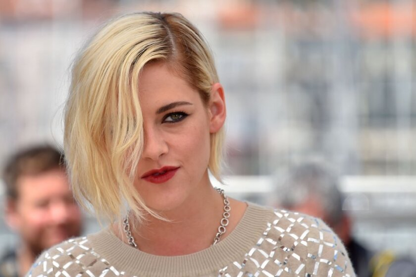 """Kristen Stewart pauses during a photo call for the film """"Personal Shopper"""" at the Cannes Film Festival in France."""