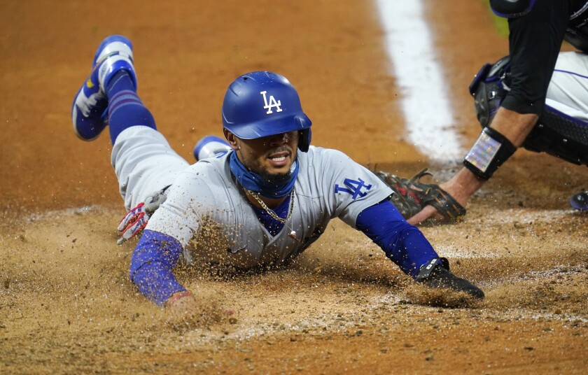 Dodgers' Mookie Betts scores after a pickoff throw.