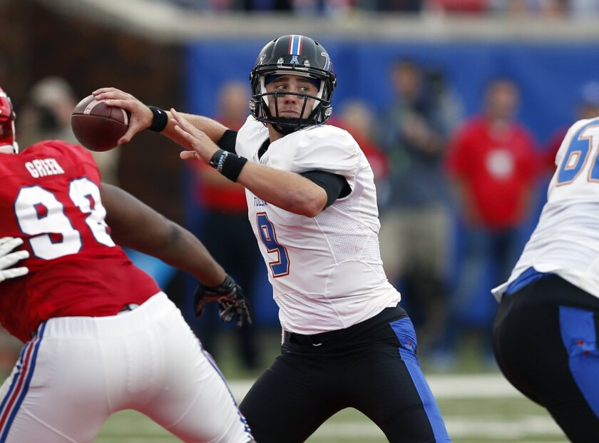 Tulsa quarterback Dane Evans (9) passes against SMU during the first half of an NCAA college football game, Saturday, Oct. 31, 2015, in Dallas. (AP Photo/Jim Cowsert)