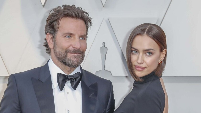 HOLLYWOOD,  CA – February 24, 2019 (L-R) Gloria Campano, Bradley Cooper, and Irina Shayk during t