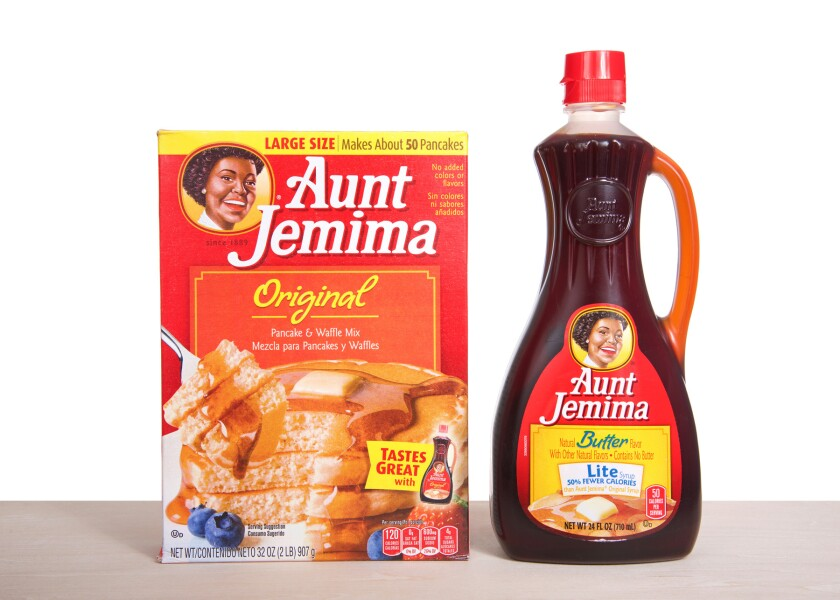 Aunt Jemima pancake mix next to a bottle of light syrup.