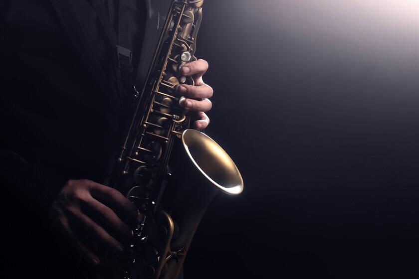 Saxophone player Saxophonist playing jazz music instrument sax alto Jazz musician hands closeup