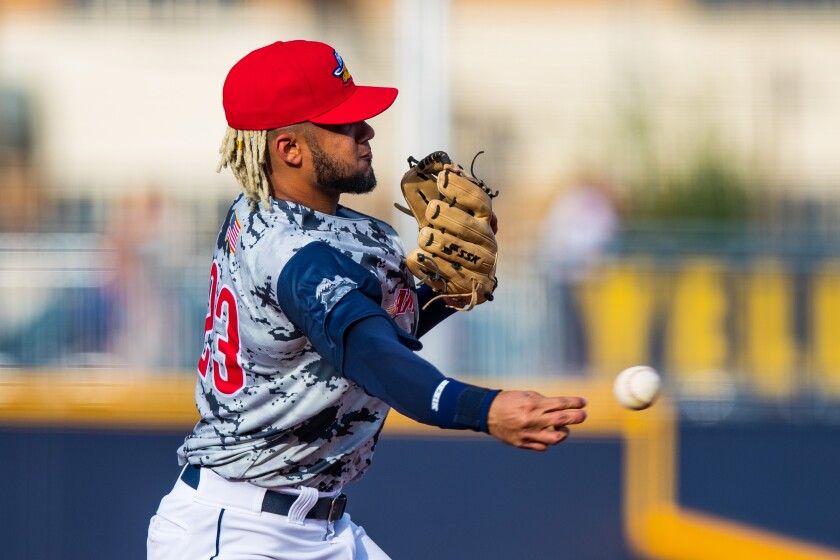 Fernando Tatis Jr. throws the ball during game for the Amarillo Sod Poodles during his rehab assignment.