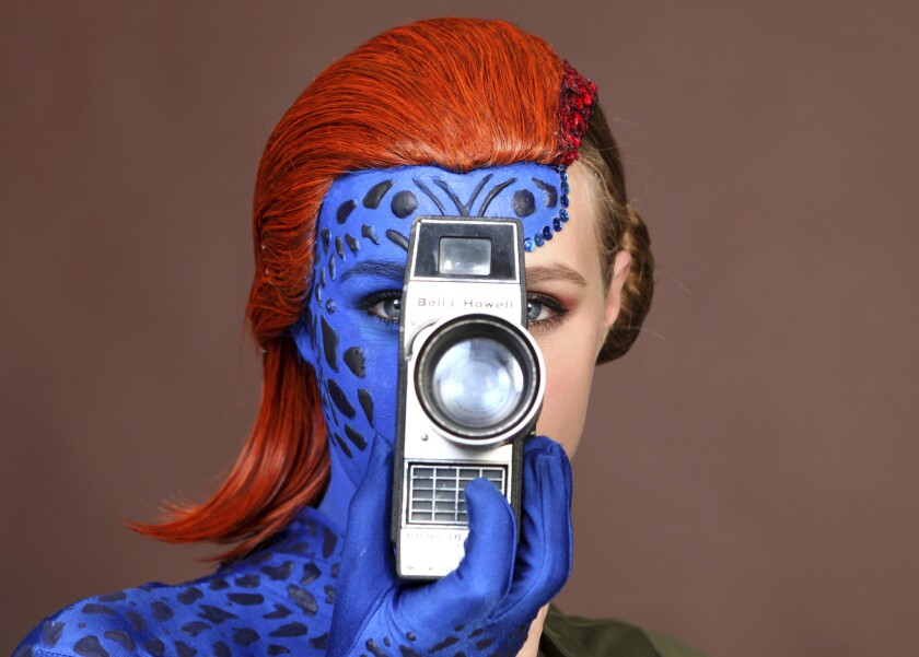 Evy Thomas, dressed as Mystique, poses for a portrait on day one of Comic-Con International on Thursday, July 18, 2019, in San Diego. (Photo by Rebecca Cabage/Invision/AP)