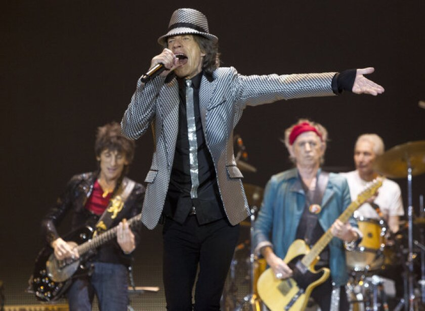 The Rolling Stones, shown during their Nov. 25 concert in London, may face a fine for playing past a 10:30 p.m. noise curfew.